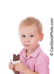Little boy holding chocolate bar over white background
