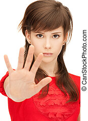 teenage girl making stop gesture - bright picture of teenage...