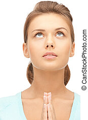 praying businesswoman - bright closeup portrait picture of...