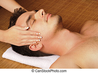 Man getting a face massage - Face massage in spa