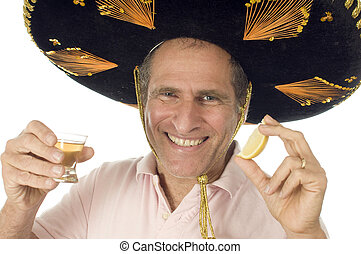 middle age senior tourist male wearing Mexican sombrero...