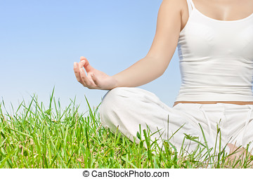 closeup of woman hands in meditation outdoors