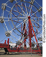 Ferris Wheel - A ferris wheel stands empty at a country...
