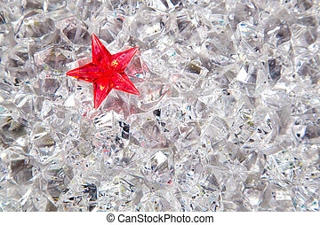 christmas red glass star on cold winter ice background