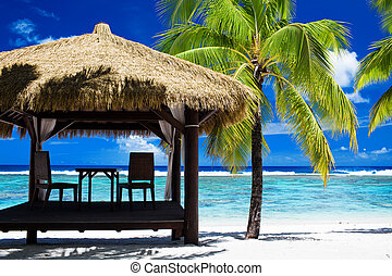 Tropical gazebo on amazing beach with palm tree - Tropical...