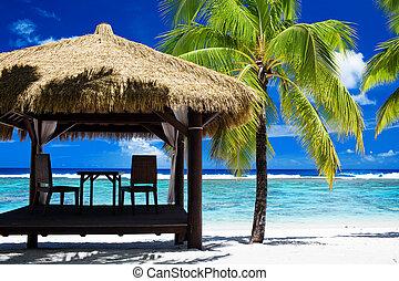 Tropical gazebo on amazing beach with palm tree