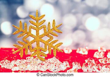 Christmas golden snowflake on ice cubes