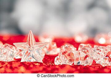 Christmas crystal star on ice cubes