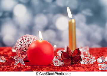 Christmas red golden candles on ice cubes
