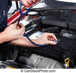 car repair. - Car inspection in car repair shop. Mechanic.
