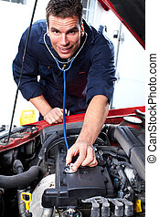 car mechanic. - Handsome mechanic working in car repair...