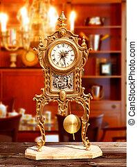 ancient vintage brass pendulum clock in classic indoor