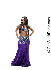 beauty dancer posing in oriental purple costume