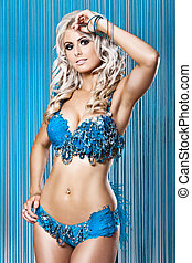 Young sexy woman in blue diamnods and feathers bikini -...