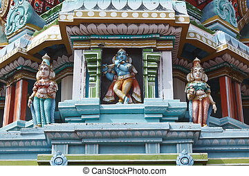 Sculptures on Hindu temple gopura (tower) - Krishna image....