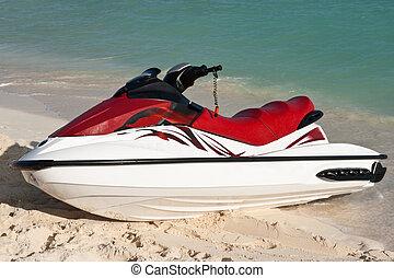 Jet ski on beach sand near sea