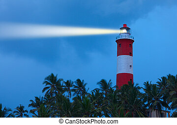 Lighthouse in night with light beam