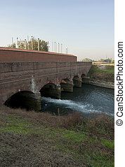 Canale Cavour - Old dam building along Canal Cavour