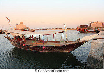 Doha dhows in the evening - Two dhows moored beside Doha's...