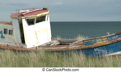 fishing boat - An old abandoned fishing boat beached on the...