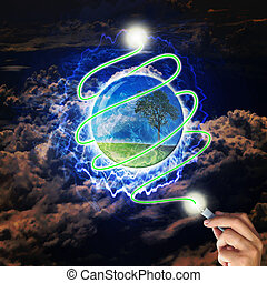 Male hand draw earth globe with tree on abstract background as conceptual image.