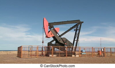 Oil pump - Oil pump against blue sky. Santa Cruz, Argentina...