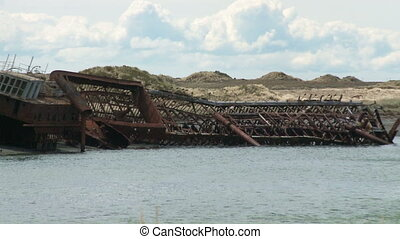 Two abandoned ships - Two old abandoned ships beached on the...