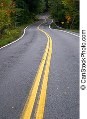 long and winding road - a long winding curvy road with...