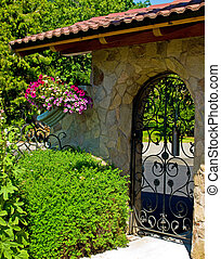 Wrought Iron Garden Gate in a Fancy Garden