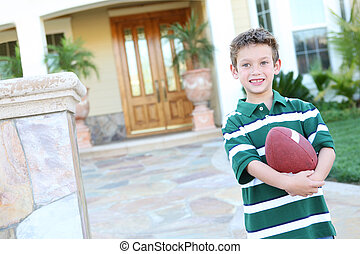 Young Boy at home with Football