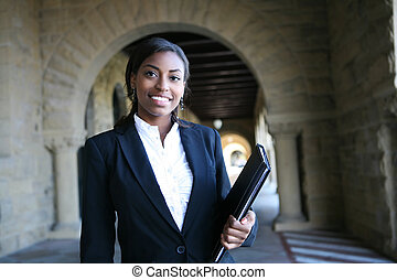 Pretty University Student - A young and pretty african...