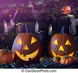Halloween pumpkins in the grave yard - Bightly lit Halloween...