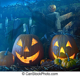 Halloween pumpkins in the grave yard - Brightly lit...