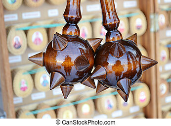 Wooden spiky souvenir mace on a a blurred background