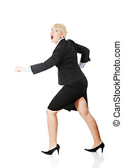 Middleaged businesswoman running against white background