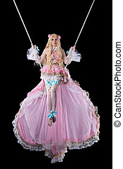 Pretty girl in fary-tale doll costume fly on wire