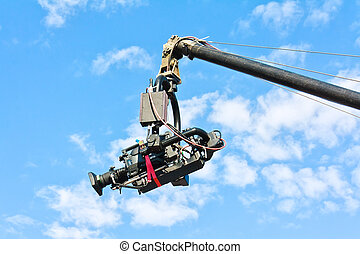 Tv camera on a crane against blue sky - Professional tv...