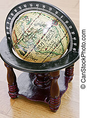 antique globe - photography of antique globe on wood floor