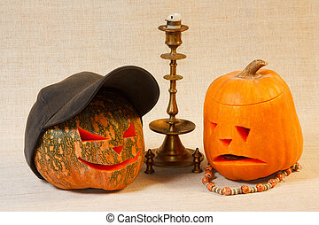 The sad and cheerful halloween pumpkin with candle from...