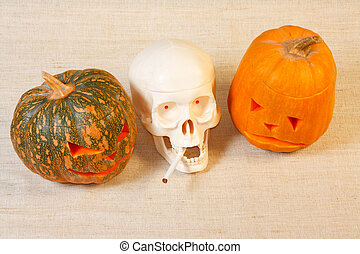 The cheerful and sad halloween pumpkin and skull with...