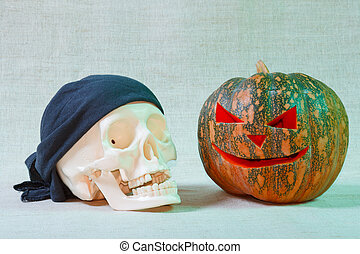 The big cheerful halloween pumpkin and skull from canvas...