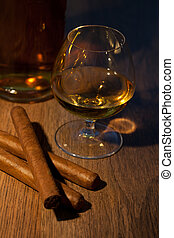 Whisky and cigars - typical havana cigars with pure whisky...