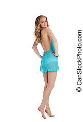 Beauty blonde woman walk in blue cloth