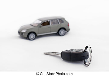 Keys and a car in the background - Car keys and a car in the...