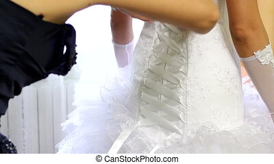 Bride is dressed in a dress
