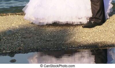 Two honeymooners around the lake