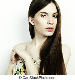 Fashion portrait of young beautiful elegant woman with dark hair