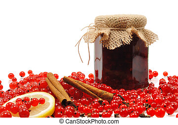 Jar of homemade red currant jam with fresh fruits