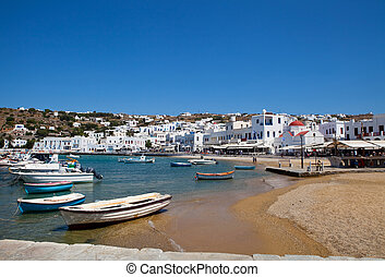 Fishing boats in Mykonos, Greece - View of the town with...