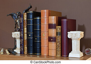 Library with old antique books bound by traditional...